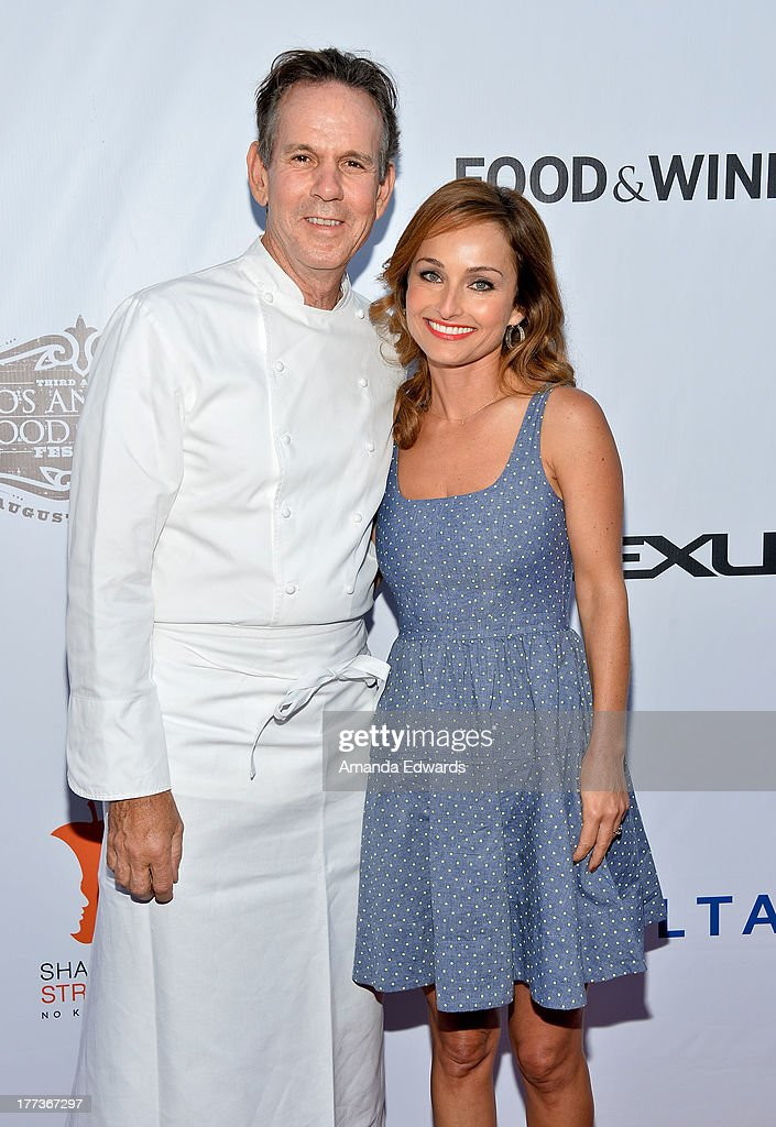 Chefs <a gi-track='captionPersonalityLinkClicked' href=/galleries/search?phrase=Thomas+Keller+-+Chef&family=editorial&specificpeople=2179375 ng-click='$event.stopPropagation()'>Thomas Keller</a> (L) and Giada De Laurentiis arrive at the opening night of the 2013 Los Angeles Food & Wine Festival - 'Festa Italiana With Giada De Laurentiis' on August 22, 2013 in Los Angeles, California.