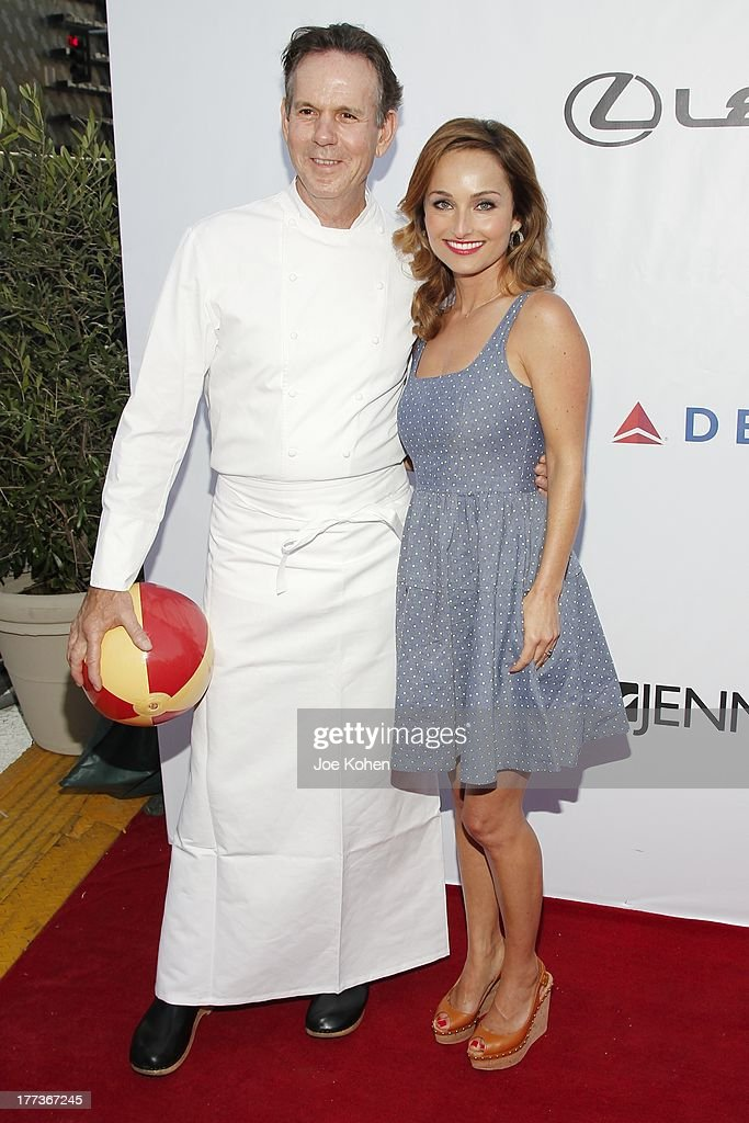 Chefs <a gi-track='captionPersonalityLinkClicked' href=/galleries/search?phrase=Thomas+Keller+-+Chef&family=editorial&specificpeople=2179375 ng-click='$event.stopPropagation()'>Thomas Keller</a> (L) and Giada De Laurentiis attend the 2013 Los Angeles Food & Wine Festival 'Festa Italiana With Giada De Laurentiis' Opening Night Gala on August 22, 2013 in Los Angeles, California.