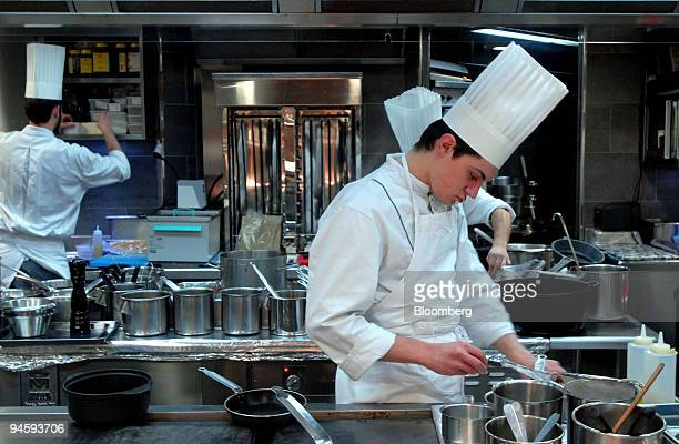 Chefs work in the kitchen at the Jules Verne restaurant on the second floor of the Eiffel Tower in Paris France on Thursday Jan 17 2008 There can be...