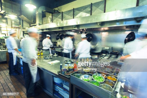 Chefs Working Busily In Chinese Kitchen Stock Photo | Thinkstock