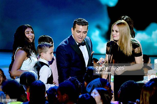 Chef/TV personality Buddy Valastro accepts the Favorite Cooking Show award for 'Cake Boss' from actress Debby Ryan onstage during Nickelodeon's 2016...