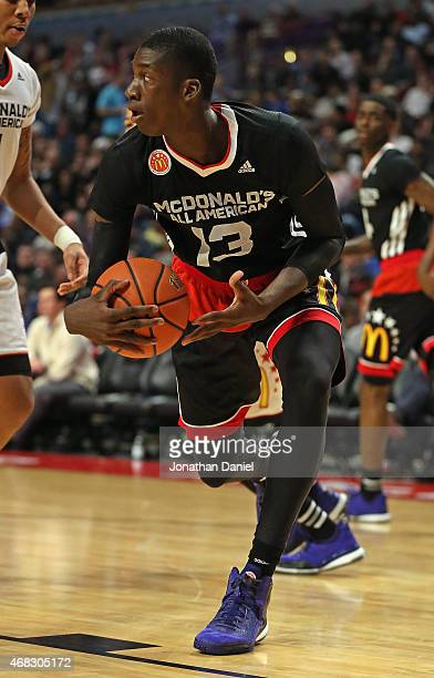 Cheick Diallo of the East team grabs a rebound during the 2015 McDonalds's All American Game at the United Center on April 1 2015 in Chicago Illinois