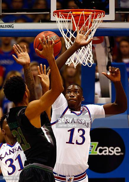 Cheick Diallo of the Kansas Jayhawks attempts to block a shot by Jarred Jones of the Loyola Greyhounds during the game at Allen Fieldhouse on...