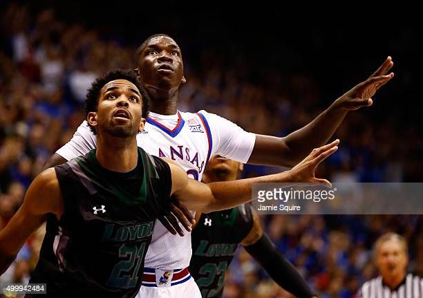 Cheick Diallo of the Kansas Jayhawks competes with Jarred Jones and Tyler Hubbard of the Loyola Greyhounds for a rebound during the game at Allen...