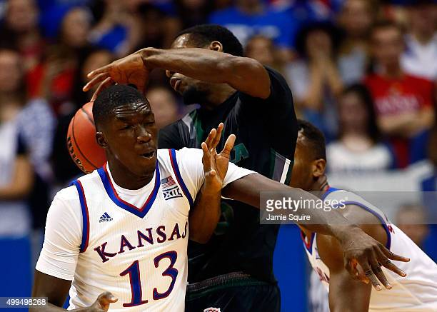 Cheick Diallo of the Kansas Jayhawks fouls Eric Laster of the Loyola Greyhounds while defending during the game at Allen Fieldhouse on December 1...