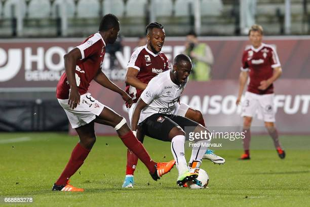 Cheick Doukoure of Metz and Ismael Diomande of Caen during the Ligue 1 match between Fc Metz and SM Caen at Stade SaintSymphorien on April 15 2017 in...