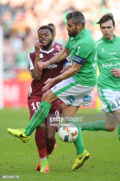 Cheick Doukoure of Metz and Loic Perin of Saint Etienne during the French Ligue 1 match between Saint Etienne and Metz at Stade GeoffroyGuichard on...