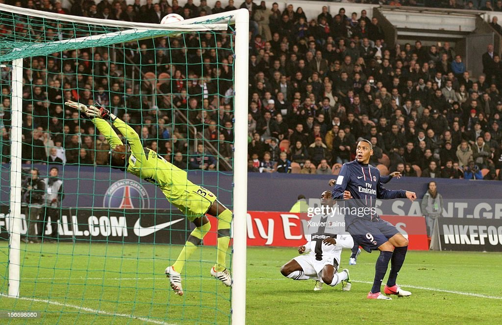 Cheick Ndiaye of Stade Rennais and <a gi-track='captionPersonalityLinkClicked' href=/galleries/search?phrase=Guillaume+Hoarau&family=editorial&specificpeople=5223496 ng-click='$event.stopPropagation()'>Guillaume Hoarau</a> of Paris Saint-Germain FC in action during the French Ligue 1 match between Paris Saint-Germain FC and Stade Rennais FC, at Parc des Princes on November 17, 2012 in Paris, France.