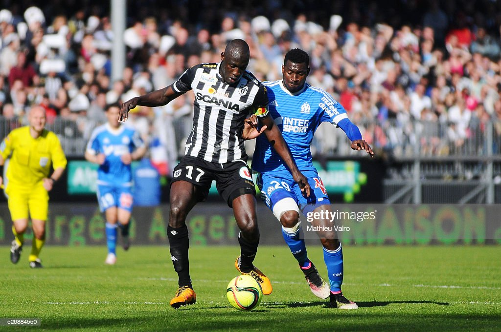 Cheick Ndoye of Angers and Andre Zambo Anguissa of Marseille during the French Ligue 1 match between Angers SCO and Olympique de Marseille on May 1, 2016 in Angers, France.