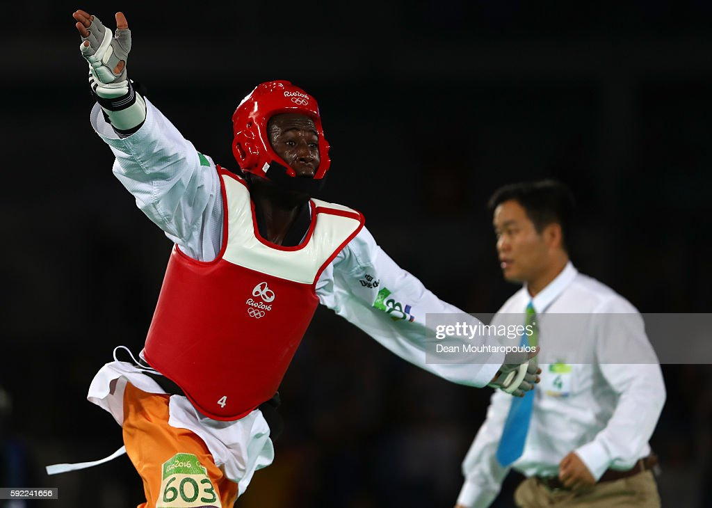 Cheick Sallah Cisse of Cote d'Ivoire celebrates winning the Men's Taekwondo -80kg Gold Medal Contest match against Lutalo Muhammad of Great Britain on Day 14 of the Rio 2016 Olympic Games at Carioca Arena 3 on August 19, 2016 in Rio de Janeiro, Brazil.