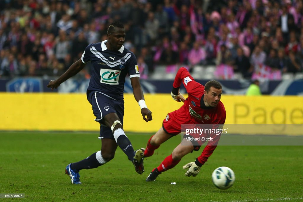 Cheick Tidiane Diabate (L) of Bordeaux goes round golakeeper Bertrand Laquait of Evian Thonon Gaillard to score the opening goal during the French Cup Final match between Evian Thonon Gaillard and FC Girondins de Bordeaux at the Stade de France on May 31, 2013 in Paris, France.