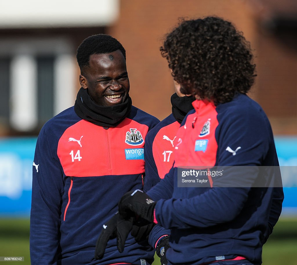 <a gi-track='captionPersonalityLinkClicked' href=/galleries/search?phrase=Cheick+Tiote&family=editorial&specificpeople=5490367 ng-click='$event.stopPropagation()'>Cheick Tiote</a> (L) and <a gi-track='captionPersonalityLinkClicked' href=/galleries/search?phrase=Fabricio+Coloccini&family=editorial&specificpeople=469707 ng-click='$event.stopPropagation()'>Fabricio Coloccini</a> (R) share a joke during the Newcastle United Training session at The Newcastle United Training Centre on February 12, 2016, in Newcastle upon Tyne, England.