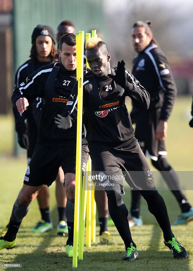 <a gi-track='captionPersonalityLinkClicked' href=/galleries/search?phrase=Cheick+Tiote&family=editorial&specificpeople=5490367 ng-click='$event.stopPropagation()'>Cheick Tiote</a> and Newcastle United players in action during a training session at the Little Benton training ground on February 28, 2013 in Newcastle upon Tyne, England.