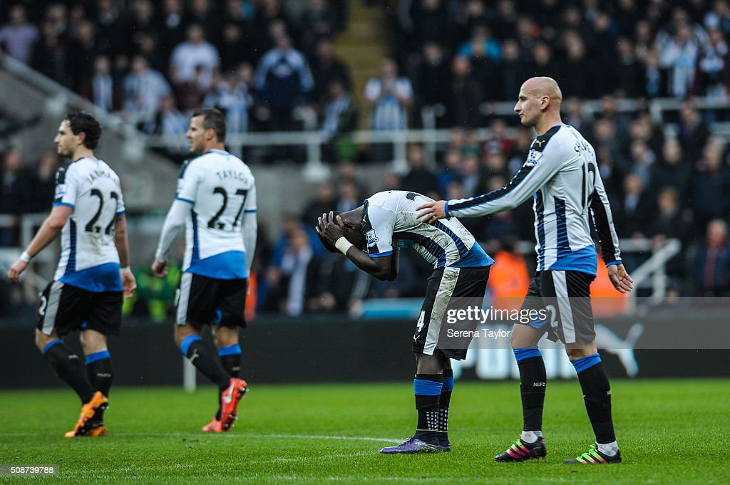<a gi-track='captionPersonalityLinkClicked' href=/galleries/search?phrase=Cheick+Tiote&family=editorial&specificpeople=5490367 ng-click='$event.stopPropagation()'>Cheick Tiote</a> of Newcastle (second from right) bows his head after his goal was disallowed and is reassured by teammate <a gi-track='captionPersonalityLinkClicked' href=/galleries/search?phrase=Jonjo+Shelvey&family=editorial&specificpeople=4940315 ng-click='$event.stopPropagation()'>Jonjo Shelvey</a> during the Barclays Premier League match between Newcastle United and West Bromwich Albion at St.James' Park on February 6, 2016, in Newcastle upon Tyne, England.