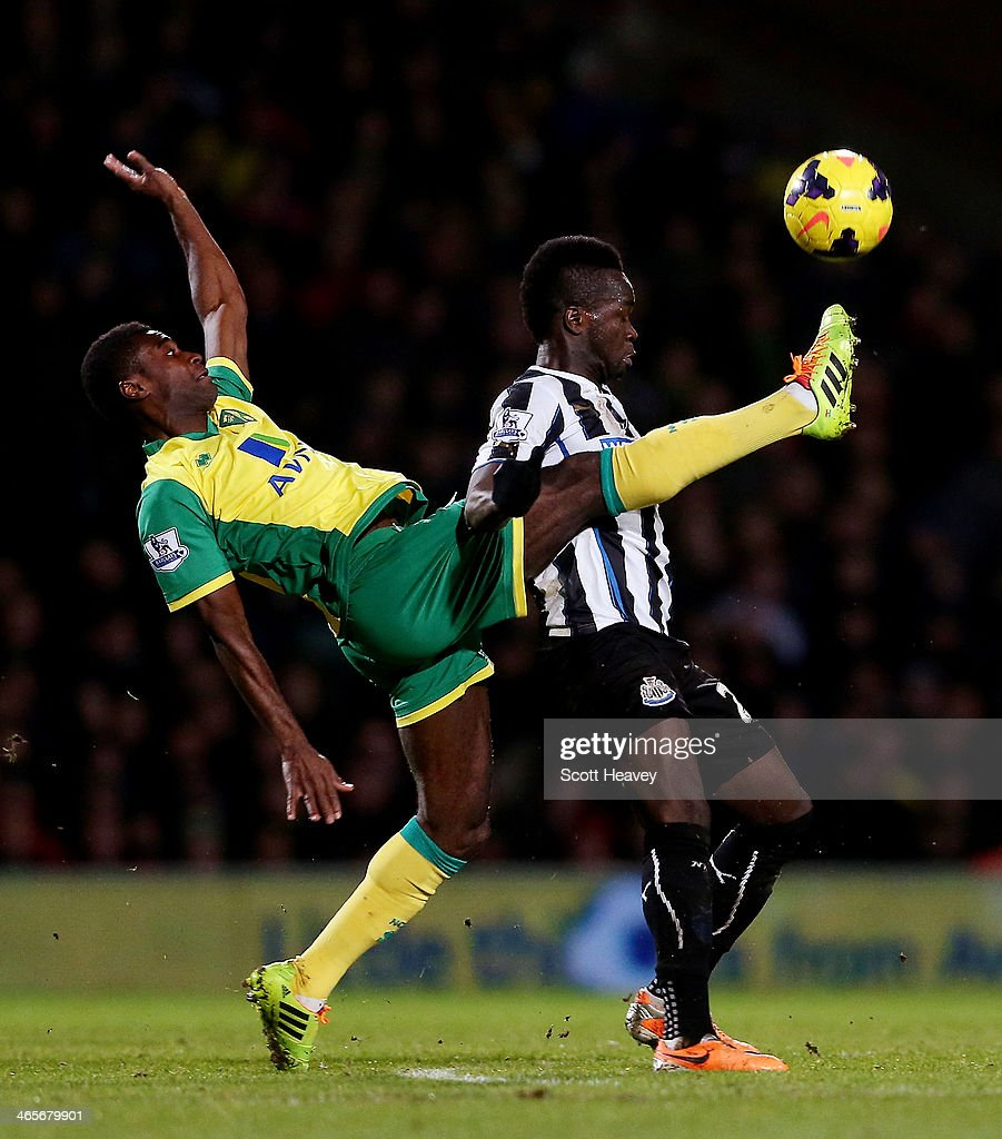 Cheick Tiote of Newcastle in action with Sebastien Bassong of Norwich during the Barclays Premier League match between Norwich City and Newcastle...