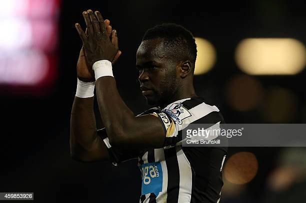 Cheick Tiote of Newcastle United applauds the supporters following the Barclays Premier League match between Burnley and Newcastle United at Turf...