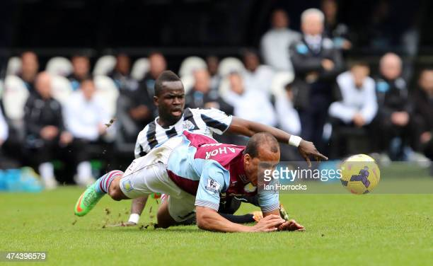 Cheick Tiote of Newcastle United brings down Gabriel Agbonlahor of Aston Villa during the Barclays Premier League match between Newcastle United and...