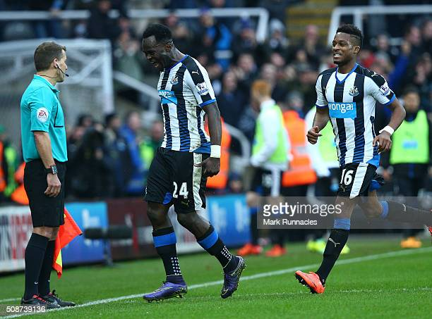 Cheick Tiote of Newcastle United celebrates scoring in the first half with team mate Rolando Aarons only to have his goal ruled out by referee Lee...