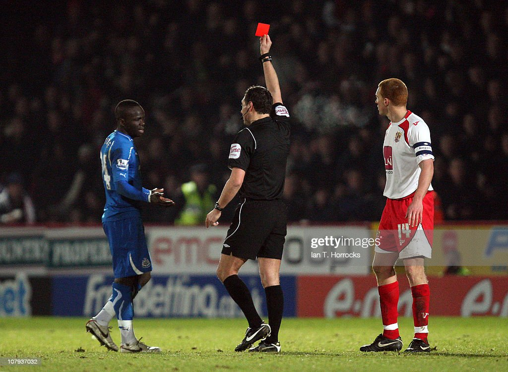Cheick Tiote of Newcastle United is shown a red card by referee Andre Marriner during the FA Cup sponsored by eon 3rd round match between Stevenage...