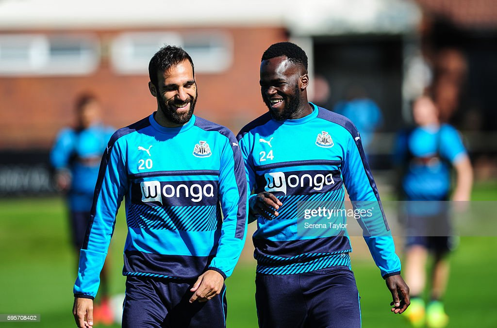 Cheick Tiote shares a joke with teammate Jesus Gamez during the Newcastle United Training Session at The Newcastle United Training Centre on August...