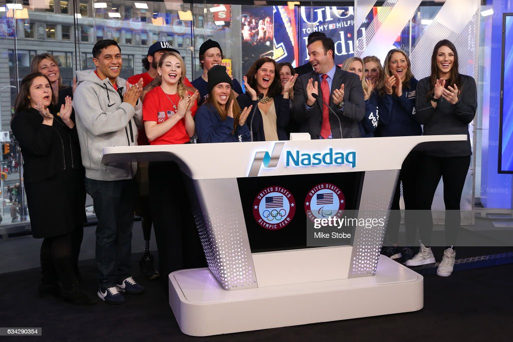 Cheif Marketing Officer Lisa Baird and memebers of Team USA Olympic and Paralympic hopefulls celebrate after ringing the closing bell at the NASDAQ Stock Market on February 8, 2017 in New York City. Team USA celebrates the one-year countdown to the Olympic Winter Games PyeongChang 2018.