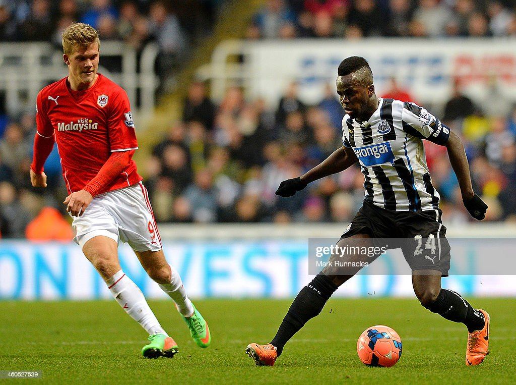 Cheik Ismael Tiote of Newcastle isclosed down by <a gi-track='captionPersonalityLinkClicked' href=/galleries/search?phrase=Andreas+Cornelius&family=editorial&specificpeople=8617821 ng-click='$event.stopPropagation()'>Andreas Cornelius</a> of Cardiff during the Budweiser FA Cup third round match between Newcastle United and Cardiff City at St James' Park on January 4, 2014 in Newcastle upon Tyne, England.