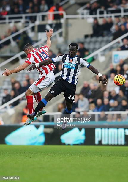 Cheik Ismael Tiote of Newcastle United and Jonathan Walters of Stoke City compete for the ball during the Barclays Premier League match between...