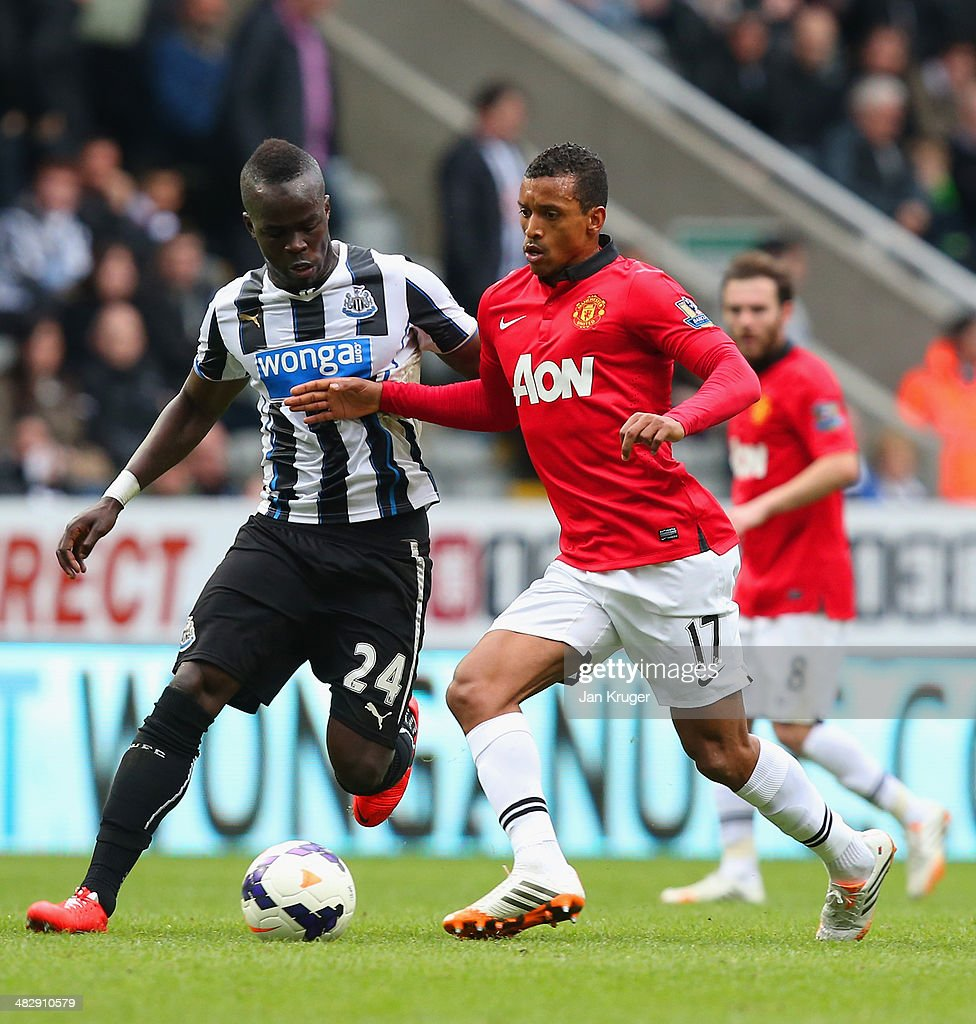 Cheik Ismael Tiote of Newcastle United and Luis Nani of Manchester United compete for the ball during the Barclays Premier League match between Newcastle United and Manchester United at St James' Park on April 5, 2014 in Newcastle upon Tyne, England.