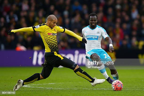 Cheik Ismael Tiote of Newcastle United battles with Adlene Guedioura of Watford during the Emirates FA Cup Third Round match between Watford and...