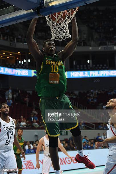 Cheik Mbodj of Senegal dunks against Canada during their 2016 FIBA Olympic men's qualifying basketball tournament in Manila on July 6 2016 / AFP /...