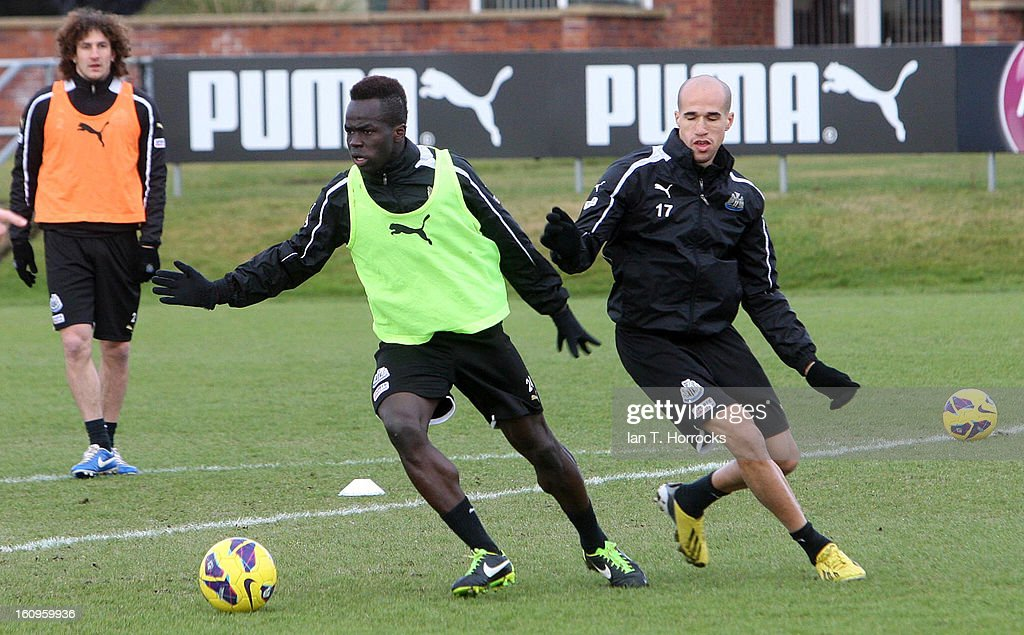 Cheik Tiote (L) with <a gi-track='captionPersonalityLinkClicked' href=/galleries/search?phrase=Gabriel+Obertan&family=editorial&specificpeople=4036746 ng-click='$event.stopPropagation()'>Gabriel Obertan</a> during a Newcastle United training session at the Little Benton training ground on February 08, 2013 in Newcastle upon Tyne, England.