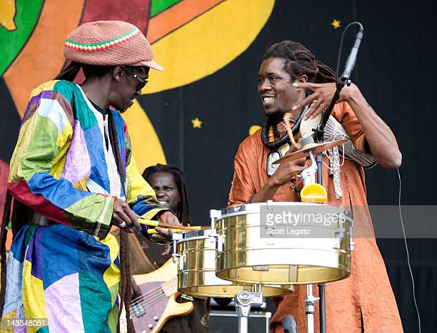 Cheikh Lo on Senegal performs during the 2012 New Orleans Jazz Heritage Festival at the Fair Grounds Race Course on April 28 2012 in New Orleans...