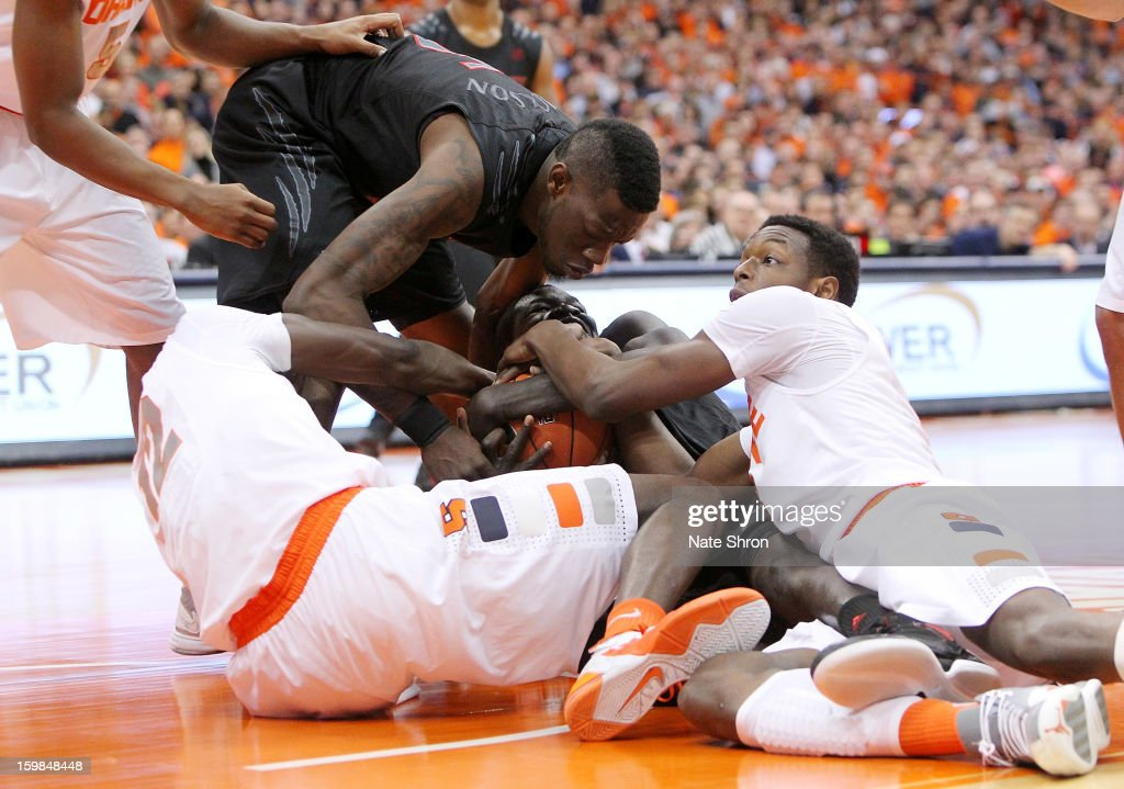 Cheikh Mbodj #13 and Justin Jackson #5 of the Cincinnati Bearcats fight for posession against Jerami Grant #3 and Baye Moussa Keita #12 of the Syracuse Orange during the game at the Carrier Dome on January 21, 2013 in Syracuse, New York.