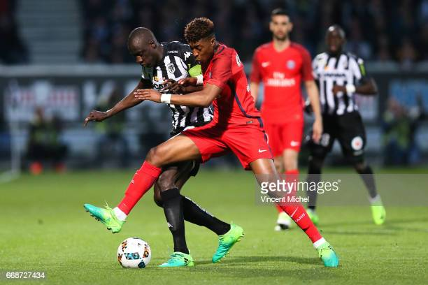 Cheikh Ndoye of Angers and Presnel Kimpembe of Paris Saint Germain during the Ligue 1 match between Angers SCO and Paris Saint Germain PSG on April...