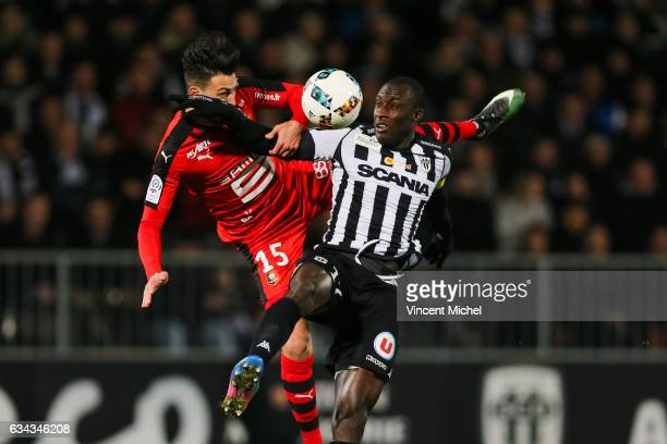 Cheikh Ndoye of Angers and Rami Bensebaini of Rennes during the French Ligue 1 match between Angers and Rennes on February 8 2017 in Angers France