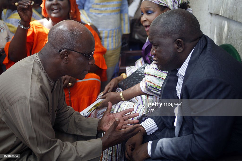 Cheikh Tidiane Sy, former justice minister (l) talks with Oumar Sarr, a leader of the PDS party of Abdoulaye Wade, on November 22, 2012 as the son of Senegal's ex-president Wade was released from police custody early Friday after lengthy questioning over graft allegations against him, a member of his entourage said. Mamadou Toure BEHAN
