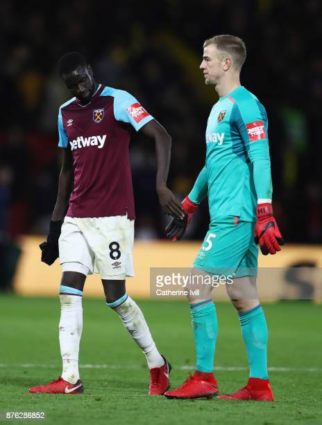 Cheikhou Kouyate and Joe Hart of West Ham United shake hands after the Premier League match between Watford and West Ham United at Vicarage Road on...
