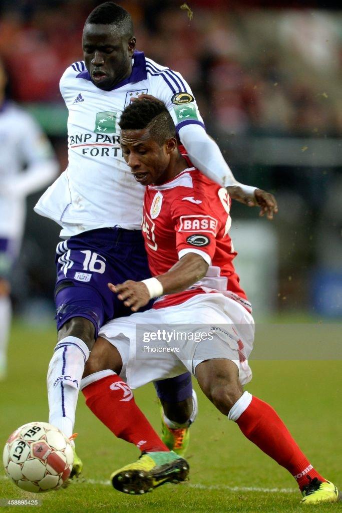 Cheikhou Kouyate of RSC Anderlecht battles for the ball with Imoh Ezekiel of Standard during the Jupiler League match between Standard Liege and RSC Anderlecht on December 22, 2013 in Liege, Belgium.