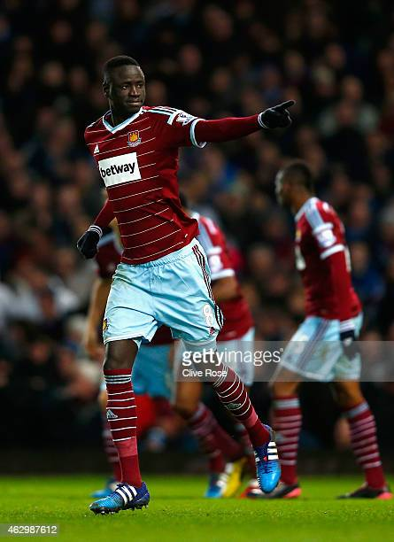 Cheikhou Kouyate of West Ham celebrates scoring the opening goal during the Barclays Premier League match between West Ham United and Manchester...