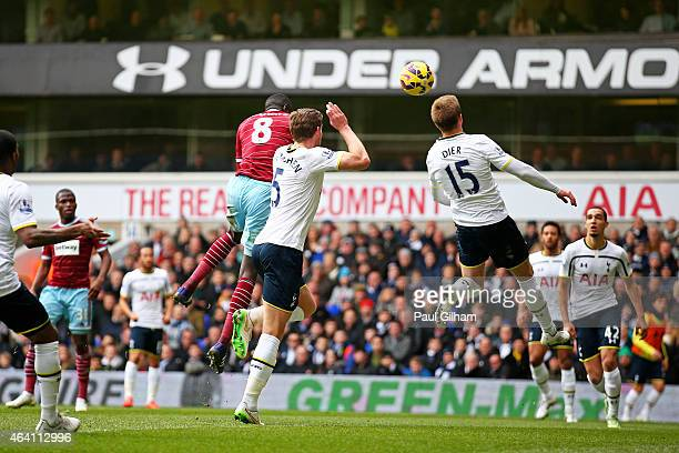 Cheikhou Kouyate of West Ham rises above Jan Vertonghen of Spurs to score the opening goal with a header during the Barclays Premier League match...