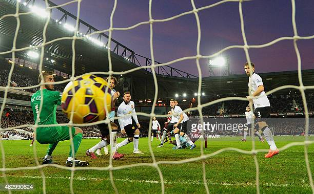 Cheikhou Kouyate of West Ham scores the opening goal past David De Gea of Manchester United during the Barclays Premier League match between West Ham...