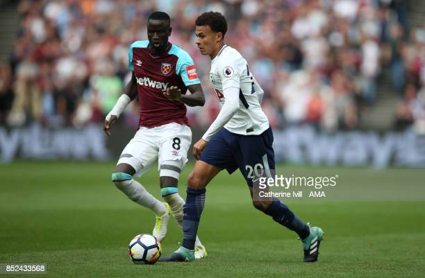 Cheikhou Kouyate of West Ham United and Dele Alli of Tottenham Hotspur during the Premier League match between West Ham United and Tottenham Hotspur...
