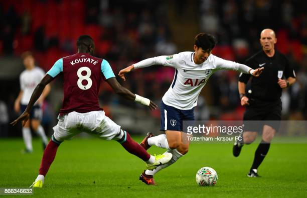 Cheikhou Kouyate of West Ham United and HeungMin Son of Tottenham Hotspur battle for possession during the Carabao Cup Fourth Round match between...