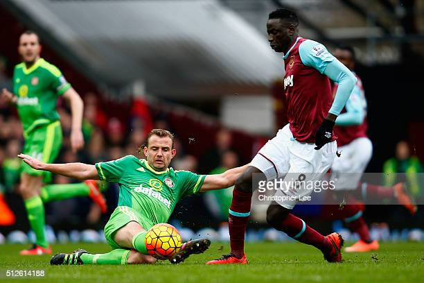Cheikhou Kouyate of West Ham United and Lee Cattermole of Sunderland compete for the ball during the Barclays Premier League match between West Ham...