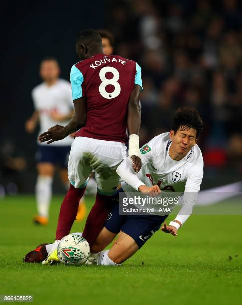 Cheikhou Kouyate of West Ham United and Son Heungmin of Tottenham Hotspur during the Carabao Cup Fourth Round match between Tottenham Hotspur and...