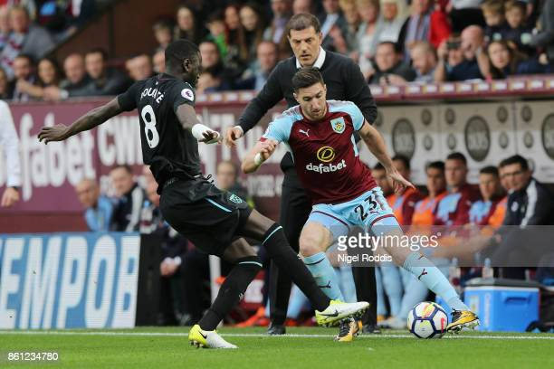 Cheikhou Kouyate of West Ham United and Stephen Ward of Burnley battle for possession during the Premier League match between Burnley and West Ham...