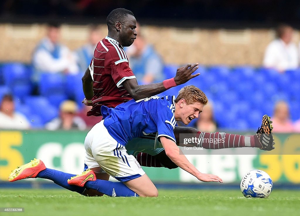 Cheikhou Kouyate of West Ham United and Teddy Bishop of Ipswich Town in action during the pre-season friendly match between Ipswich Town and West Ham United at Portman Road on July 16, 2014 in Ipswich, England.