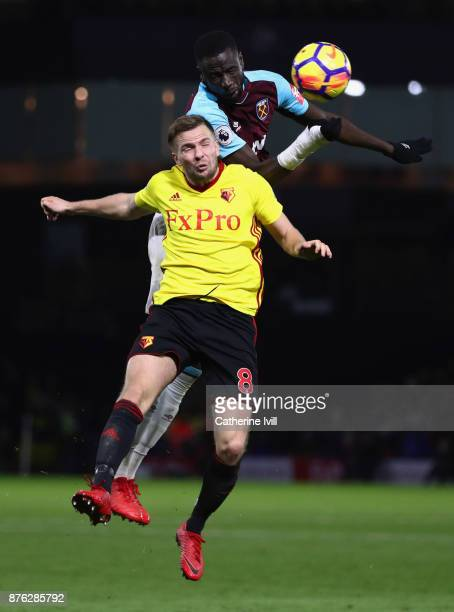Cheikhou Kouyate of West Ham United and Tom Cleverley of Watford jump for the ball during the Premier League match between Watford and West Ham...