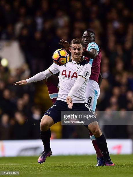 Cheikhou Kouyate of West Ham United and Vincent Janssen of Tottenham Hotspur battle for possession during the Premier League match between Tottenham...