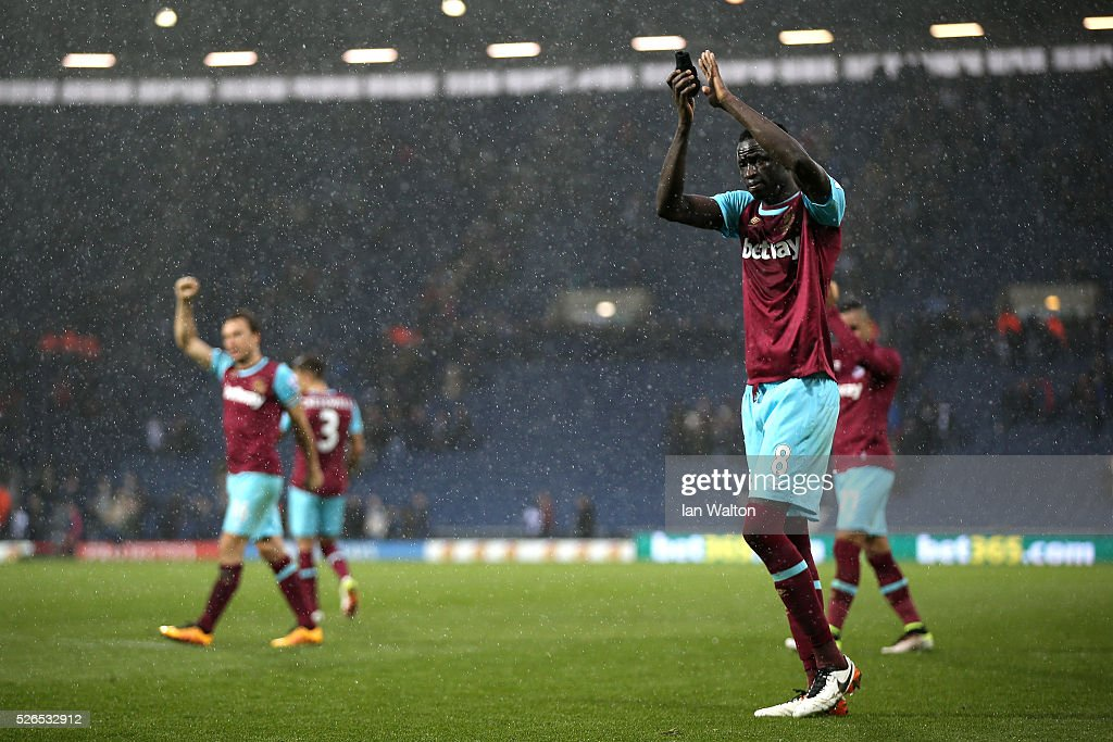 Cheikhou Kouyate of West Ham United applauds the away supporters after his team's 3-0 win in the Barclays Premier League match between West Bromwich Albion and West Ham United at The Hawthorns on April 30, 2016 in West Bromwich, England.